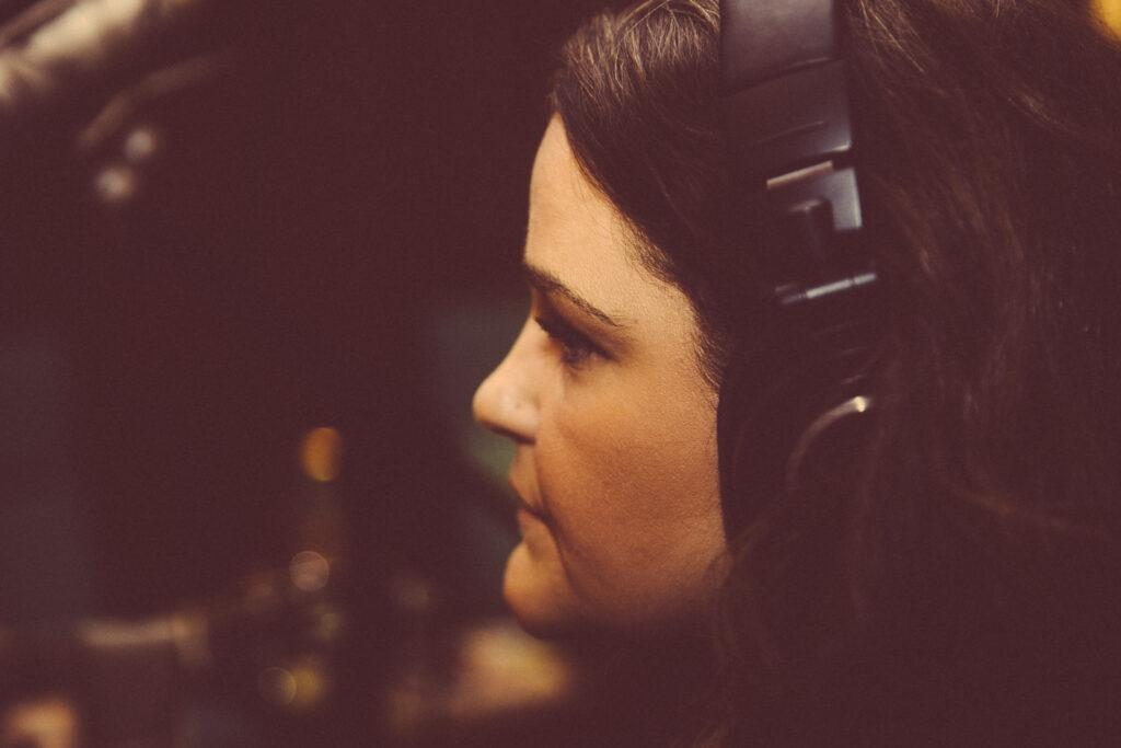 Artist listens to headphone mix.
