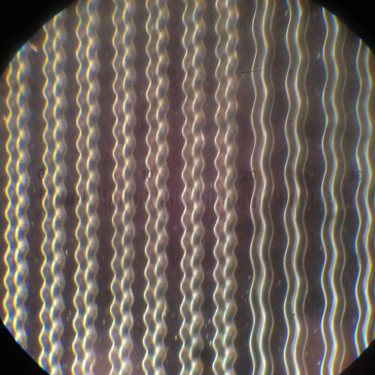 vinyl production grooves under microscope